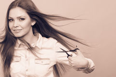 Female barber with trimmers scissors. Royalty Free Stock Photos