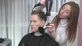 Female barber using duster brush. Attractive caucasian guy in barbershop stock video