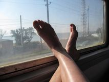 The female bare feet of the traveler on the train - conceptual photo Royalty Free Stock Photos