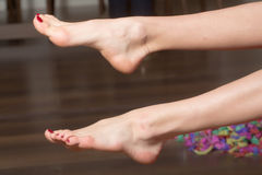 Female bare feet Stock Images