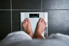 Female bare feet with weight scale. Top view Royalty Free Stock Image