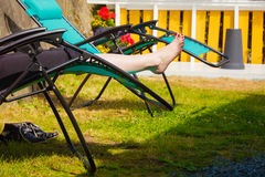 Female bare feet. Woman relaxing on sunbed Royalty Free Stock Image