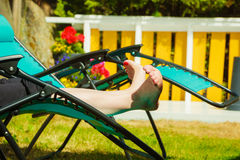 Female bare feet. Woman relaxing on sunbed Royalty Free Stock Photography