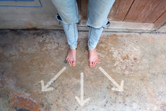 Female Barefeet with Drawn Different Direction Arrows on the Concrete Background. Great For Any Use Royalty Free Stock Photo