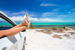 Female barefoot from the window of a car on Stock Photography