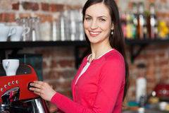 Female barista making coffee Stock Image