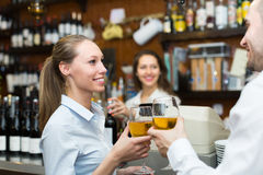 Female barista and two clients Stock Photography