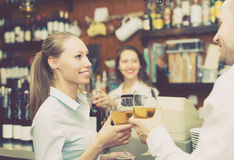 Female barista and two clients. Small bar with female barista and two clients at counter stock photos