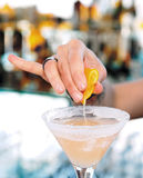 Female Bartender Is Squeezing Orange Juice Into Glass Royalty Free Stock Photo
