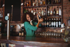 Female bartender mixing a cocktail drink in cocktail shaker. At counter royalty free stock images