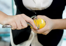 Female bartender peeling lemon royalty free stock photography