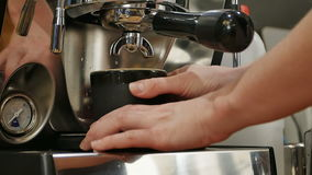 Female bartender in the workplace, makes coffee using coffee machine. Close up. Slow motion. Professional shot in HD resolution. 089. You can use it e.g. in stock footage