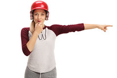 Female baseball coach blowing a whistle and pointing right Stock Photos