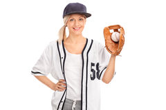 Female baseball player holding a ball Royalty Free Stock Photography