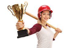 Female baseball player holding a bat and a gold trophy Stock Photo