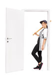 Female baseball player leaning on a door Royalty Free Stock Photo