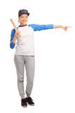 Female baseball player pointing right Stock Photos