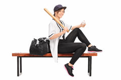 Female baseball professional holding a bat Royalty Free Stock Photography