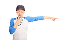 Female baseball referee blowing a whistle Royalty Free Stock Photo