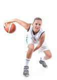 Female basketball player in action. Isolated on white background, motion blur Royalty Free Stock Photo