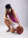 Female basketball player with ball Stock Photos