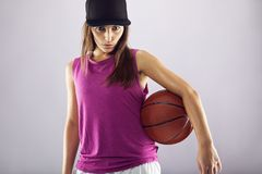Female basketball player looking confident Royalty Free Stock Photos