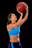 Female basketball player shooting Stock Image