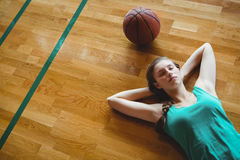 Female basketball player sleeping in court Royalty Free Stock Image