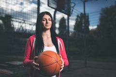 Female basketball player training outdoors on a local court Stock Photography