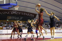 Female Basketball players in action. VENICE, ITALY - April, 10th 2010: female basket players in action at Premier League finals Match (A1): Umana Venezia  vs Stock Photography