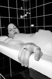 Female and bath Stock Images