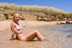 Female on the beach Stock Photo