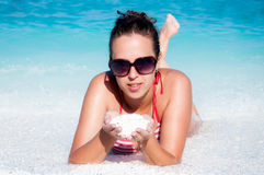 Female on the beach Stock Image