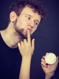 Female beautician apply cream on male mouth. Royalty Free Stock Image