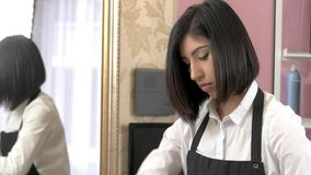 Female beautician dying hair. Beauty salon employee. Best hair color specialist stock video