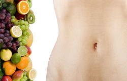 Female beautiful body and fresh fruits Stock Photo