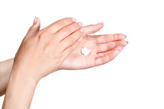 Female beautiful delicate manicured hands with moisturizing cream Royalty Free Stock Photos