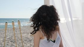 Female with beautiful face smiling, bungalow with white curtains on beach, women on summer vacation by ocean, happy stock video