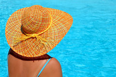 Female beauty enjoying her summer vacation at swimming pool Stock Photos
