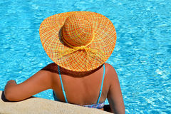 Female beauty enjoying her summer vacation at swimming pool Stock Image