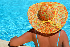 Female beauty enjoying her summer vacation at swimming pool Stock Photo
