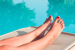 Female beauty feet with painted red nails Royalty Free Stock Photo
