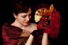 Female beauty, like a painting. Portrait of a woman, holding carnival mask Stock Photography