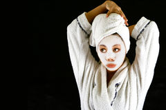 A female with beauty mask. On the face , after a shower, drying her hair stock photography