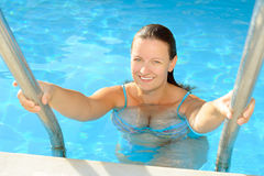 Female beauty posing in the swimming pool Stock Photography