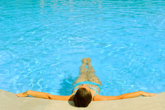 Female beauty relaxing in the swimming pool Royalty Free Stock Images