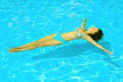 Female beauty relaxing in the swimming pool Stock Photo