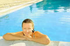 Female beauty relaxing in the swimming pool Royalty Free Stock Photos