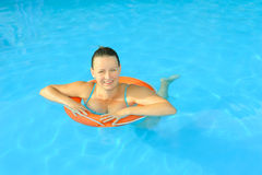Female beauty relaxing in swimming pool Stock Photography