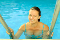 Female beauty relaxing in swimming pool Stock Photo